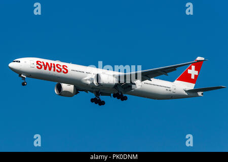 Boeing 777-3DE ER (HB-JNC) operated by Swiss on approach to San Francisco International Airport (KSFO), San Francisco, California, United States of America - Stock Photo