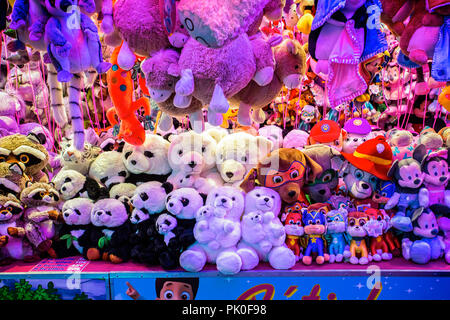 A collection of cuddly toy prizes at a funfair in Arras, France taken on 31 August 2018 - Stock Photo