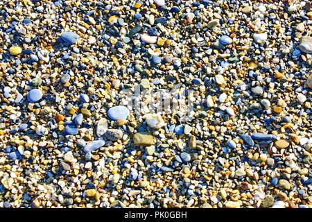 Sea pebbles. Small stones gravel textures background