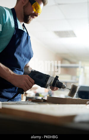 Carpenter working with drill - Stock Photo