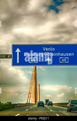 Directional overhead motorway sign before Bridge over the Ruhr on A-40 autobahn near Duisburg in Germany - Stock Photo