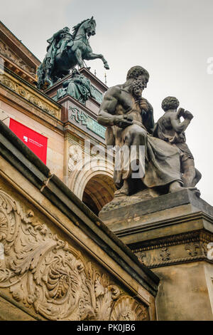 Close up Architectural detail and statuary atop the National Gallery on Bodenstrasse in Berlin, Germany - Stock Photo