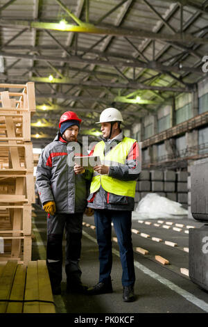 Two Workers at Modern Plant - Stock Photo