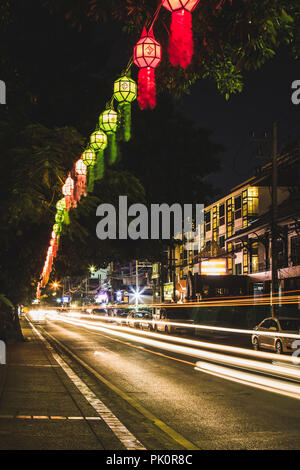 Lanterns and light trails at Loy Krathong festival in Chiang Mai Thailand - Stock Photo