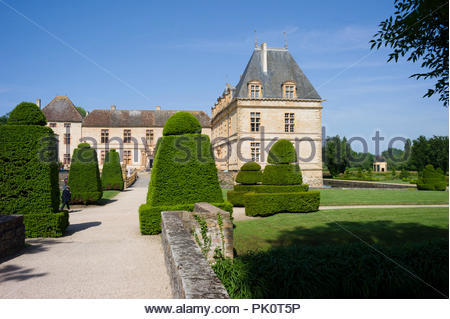 A chateau in Burgundy, France set within ornamental gardens - Stock Photo
