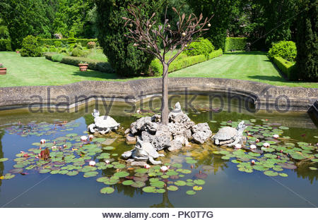 An ornamental pond with stone turtles in the gardens of a chateau in Burgundy, France. - Stock Photo