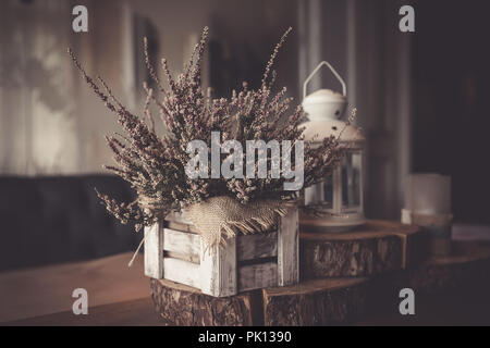 Autumn still life in retro style. Toned image.Pink heather in pot, candles, vintage shutters on background. White lantern. Home interior decoration,Hello autumn, decor details. Vintage - Stock Photo