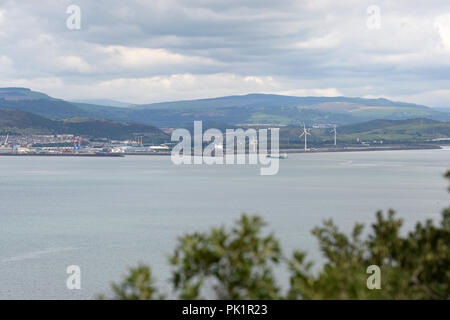 A ship is arriving on the high tide at the entrance to Swansea harbour -proposed site of tidal lagoon. View from Mumbles hill. - Stock Photo