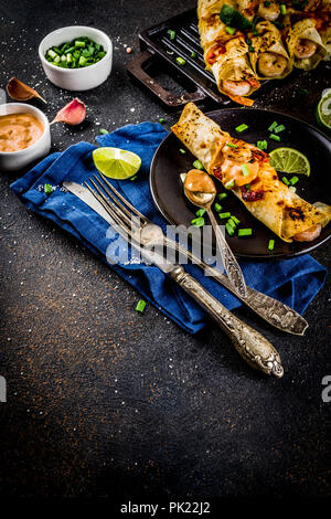 Mexican latin american food, Baked Roasted Shrimp Enchiladas with Jalapeno and Lime Cream Sauce - Stock Photo