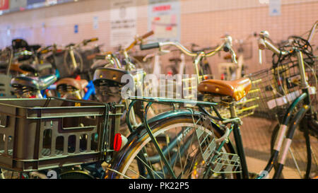 TOKYO, JAPAN - SEPTEMBER 8, 2018: One of many bicycle parking with several bicycles in a row in Asakusa district in Tokyo. - Stock Photo