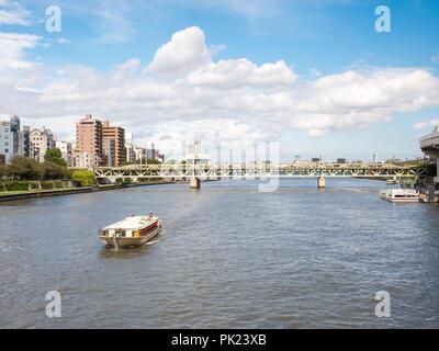 TOKYO, JAPAN - SEPTEMBER 8, 2018. Cruise boat sailing along Sumida River in a hot summer day. - Stock Photo