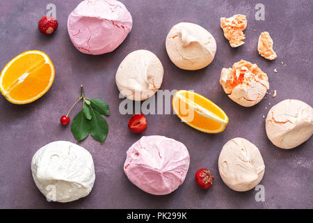Colorful meringues on a beautiful background. The view from the top,flat lay - Stock Photo