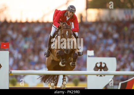 Aachen, Deutschland. 19th July, 2018. Steve GUERDAT (SUI) on Hannah jumping over the obstacle. Action/single action. CHIO Aachen 2018, S8, Mercedes-Benz Nations Cup, Team Jumping Competition. 19.07.2018 in Aachen/Germany. | Usage worldwide Credit: dpa/Alamy Live News - Stock Photo