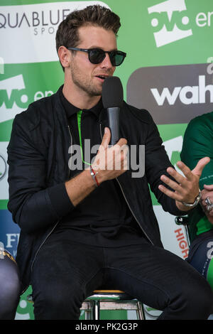 London, UK. 9th September, 2018. Cyclist Adam Blythe being interviewed before the 77km London Stage (Stage 8) of the OVO Energy Tour of Britain cycle race. Credit: Mark Kerrison/Alamy Live News - Stock Photo