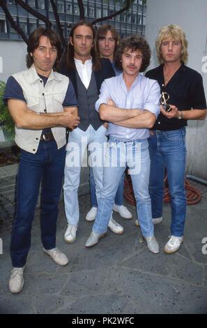 Status Quo - September 1983 - Berlin. Francis Rossi - lead guitar, vocals, Alan Lancaster - bass, vocals, Rick Parfitt - rhythm guitar, vocals, Andy Bown - keyboards, Pete Kircher - drums | usage worldwide - Stock Photo