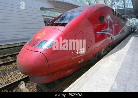 Aerodynamics on public transport SNCF TGV Thalys PBKA streamlined electric locomotive high speed passenger train at Liege Belgium EU railway station - Stock Photo