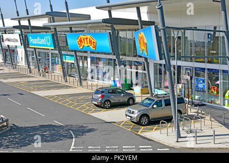 Looking down on Smyths Toys & Poundland shopping stores & wheelchair user disability parking bay space Lakeside retail park Thurrock Essex England UK - Stock Photo