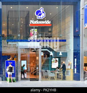 Glass front wall Nationwide building society premises & logo ATM in shopping mall at Westfield shopping centre Stratford City Newham East London UK - Stock Photo