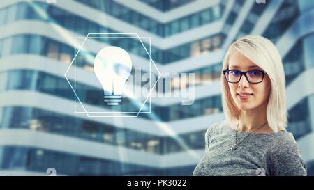 Beautiful woman wearing eyeglasses looking at camera having idea as light bulb icon glow on digital screen interface. Creativity artificial intelligen - Stock Photo