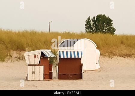 A group of beach chairs - beach chairs on beautiful beach with sand dunes in the background at blue sky - luxury vacation - Stock Photo