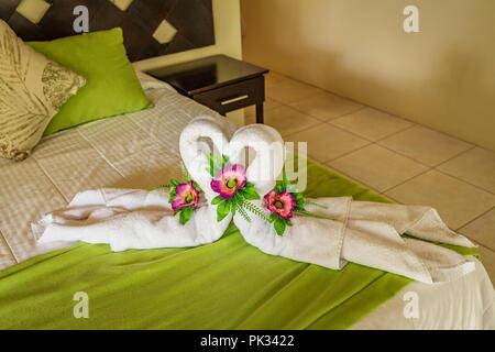 Towel displayed as Swans, LaCusinga Hotel, Costa Rica - Stock Photo