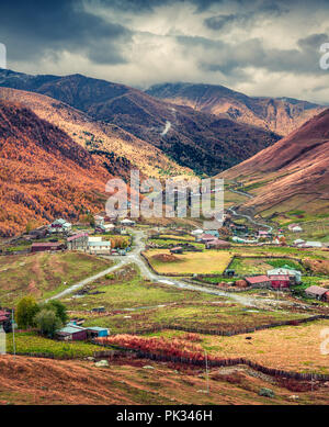 View from a bird's eye of Ushguli village - UNESCO World Heritage Site. Ancient svan towers in Ushguli village at sunny autumn morning in the Caucasus - Stock Photo