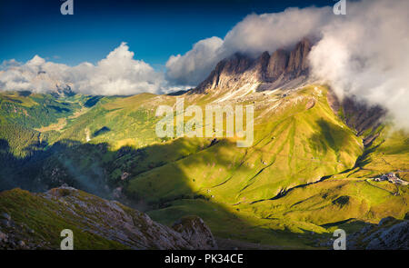 Dramatic summer morning on the Sassolungo (Langkofel) group. View from the Sella pass. National Park Dolomites, South Tyrol. - Stock Photo