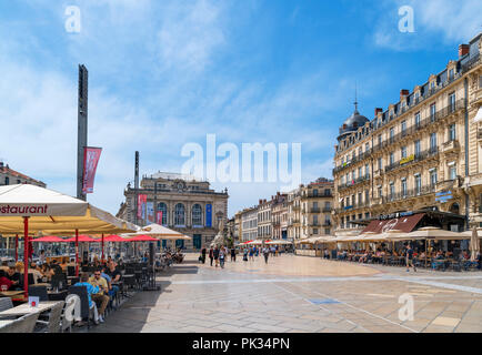 Cafes and restaurants on Place de la Comédie looking towards the Opera house, old town, Montpellier, Languedoc, France - Stock Photo