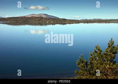 From Arduaine Gardens Viewpoint. West, across a flat calm Loch Melfort. To  Shuna, Luing, Scarba, Lunga. Arduaine, Argyll - Stock Photo