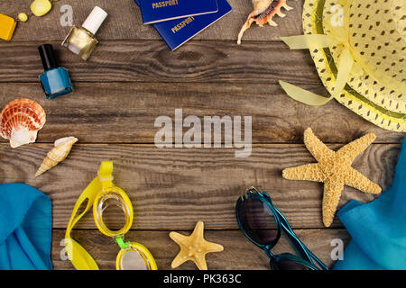 Summer accessories on wooden old background. Top view. - Stock Photo