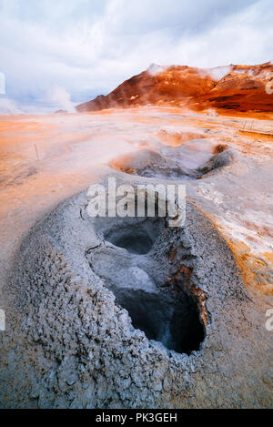 Namafjall - geothermal area in field of Hverir. Landscape which pools of boiling mud and hot springs. Tourist and natural attractions in Iceland - Stock Photo