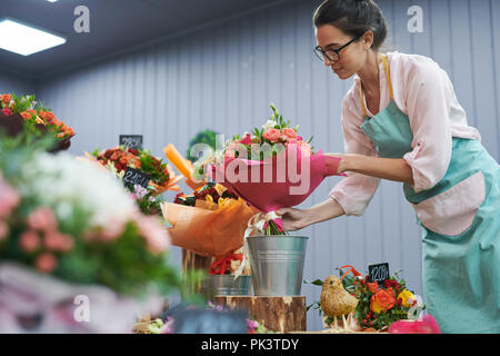 Florist Working in Shop - Stock Photo