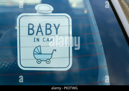 Close up of the baby in car board sign on the car back glass. - Stock Photo