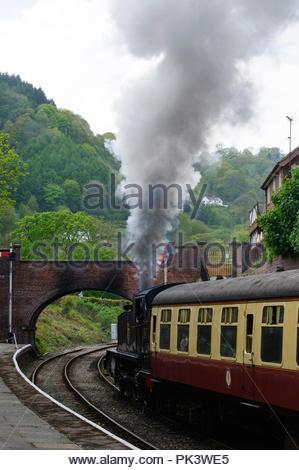 Steam train leaving Llangollen steam railway station in Llangollen, Denbighshire, Wales. - Stock Photo