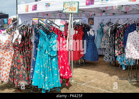 vintage style dresses on a clothes rail at a vintage retro festival, Design ideen