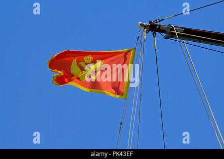 Montenegro flag with Eagle flying at wind - Stock Photo