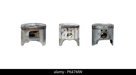 Burned, damaged car pistons. Isolated on a white background with a clipping path. - Stock Photo