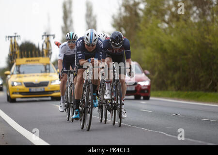 Riders taking part in the Tour de Yorkshire 2018 heading out of Holme upon Spalding Moor, East Yorkshire - Stock Photo