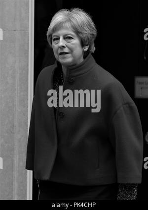 London, UK, 24th April 2018. Theresa May British Prime Minister seen leaving Downing street ( Image digitally altered to monochrome ) - Stock Photo