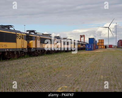 Rows of Electric Train Cabs at Amsterdam Container Port awaiting recycling or further disposal at a future date, Holland. - Stock Photo