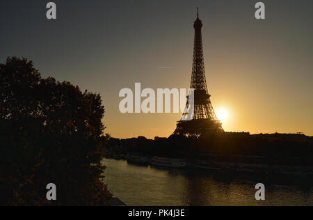 View of the Eiffel Tower at sunrise from the subway train. - Stock Photo
