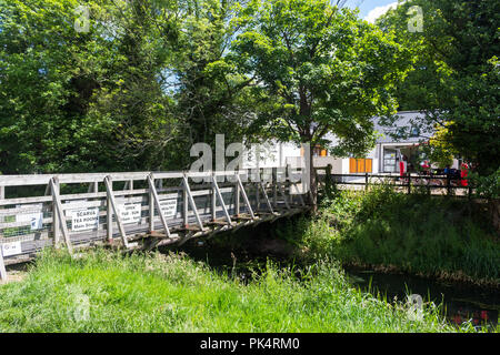 Wooden bridge across a disused canal linking the towpath to Scarva Tea Rooms and Scarva Visitor Centre. Scarva, County Down, N.Ireland. - Stock Photo