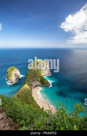 Portrait view of Kelingking beach from above. - Stock Photo