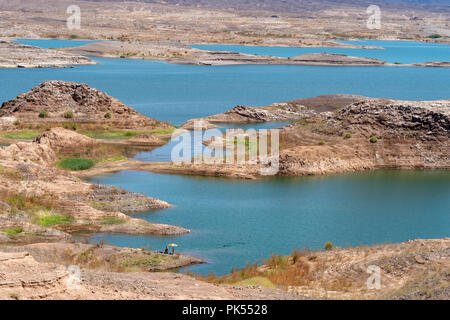 View of Lake Mead on a sunny day from above. This is a man made lake in the Lake Mead National Recreation Area of Nevada - Stock Photo