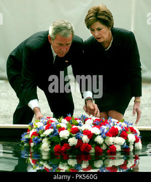 New York, NY - September 10, 2006 -- United States President George W. Bush and first lady Laura Bush lay a wreath in commemoration of the fifth anniversary of the September 11, 2001 terrorist attacks on New York City and Washington, D.C. at Ground Zero, the site where the World Trade Center Tower 2 stood in New York, New York on Sunday, September 10, 2006. Credit: Ron Sachs / Pool via CNP/ MediaPunch - Stock Photo