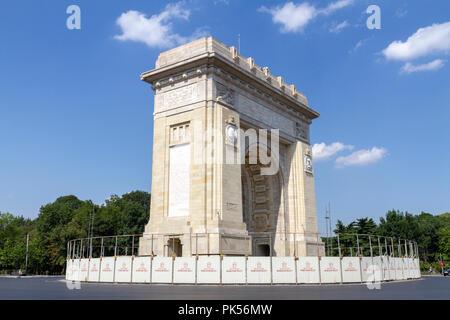 The Arcul de Triumf (Arch Of Triumph) on Kiseleff Road in Bucharest, Romania. It is modelled in the Arc de Triomphe in Paris. - Stock Photo