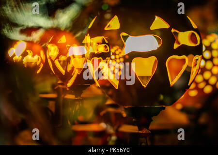 Abstract bakground from holidays city illumination, electric street lamp decorated with carved pumpkins. Concept of harvest holidays, Thanksgiving Day, Halloween. - Stock Photo