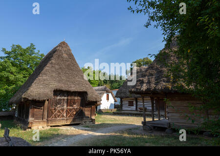 A Romanian settlement of the Mara Valley from 1775 in the Dimitrie Gusti National Village Museum in Herăstrău Park, Bucharest, Romania. - Stock Photo