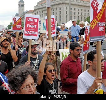Protesters against hate and racism leave Freedom Square in Washington DC on August 12, 2018 to march to a nearby alt-right rally. - Stock Photo