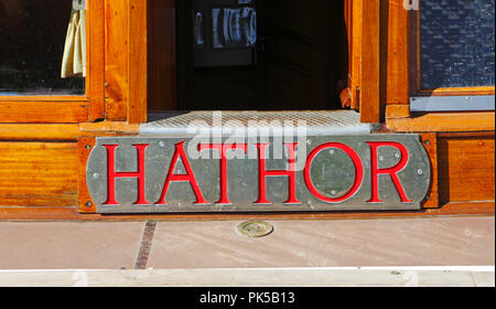 A view of the nameplate of the Norfolk Pleasure Wherry Hathor moored on the River Ant by How Hill, Norfolk, England, United Kingdom, Europe. - Stock Photo